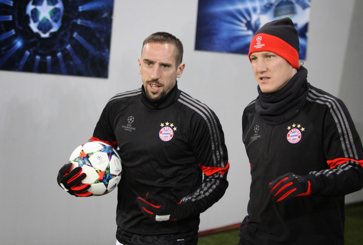 Franck Ribery talks with Bastian Schweinsteiger of Bayern Munich
